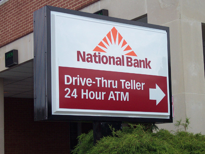 Directional sign for Drive-thru and ATM at National Bank.
